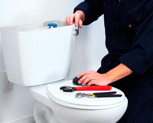 Plumber doing bathroom plumbing