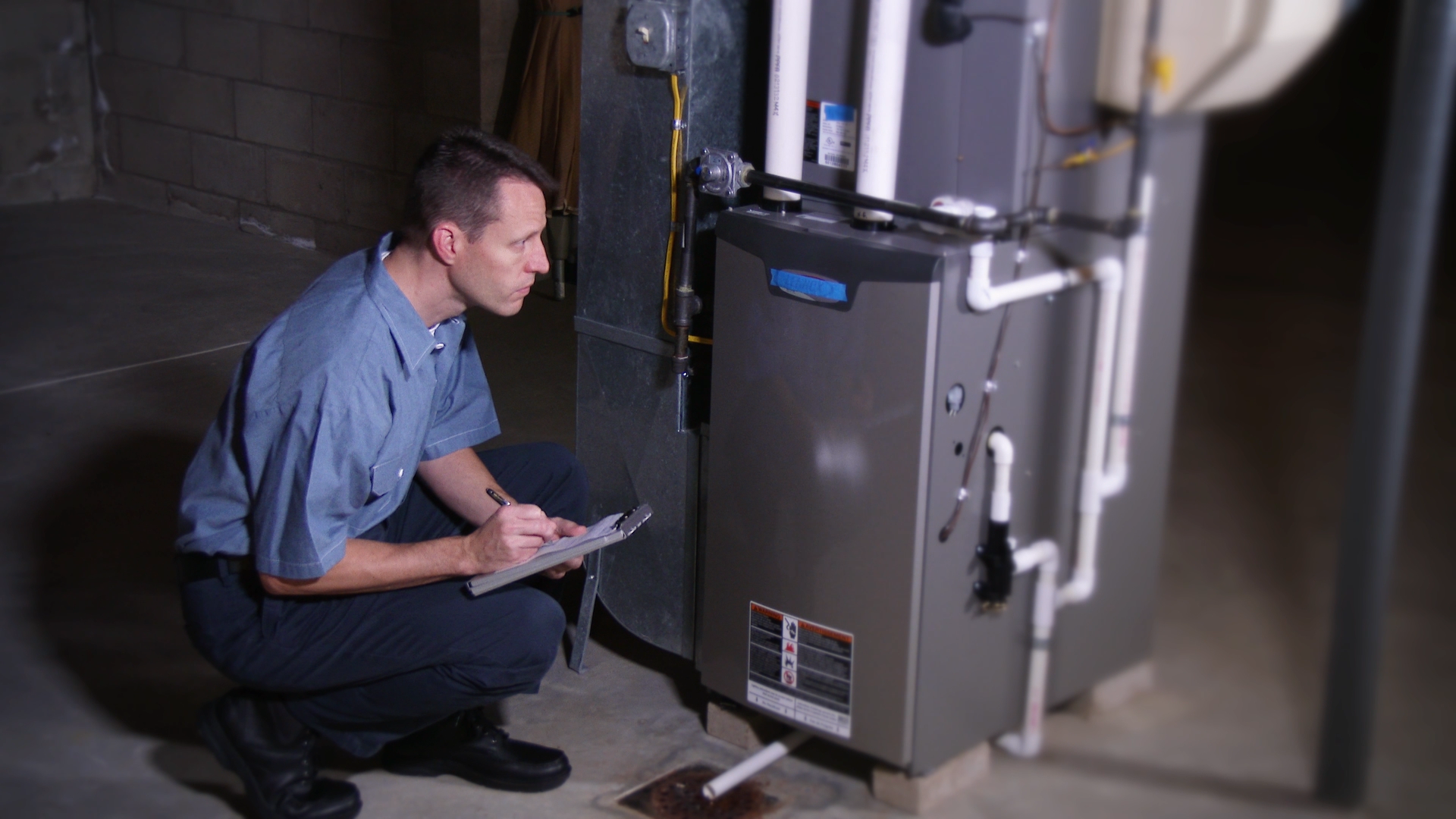 Service man looking at furnace