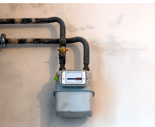 Gas meter on house with gas pipes