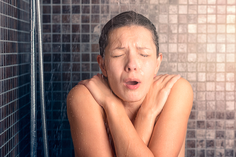woman taking cold shower