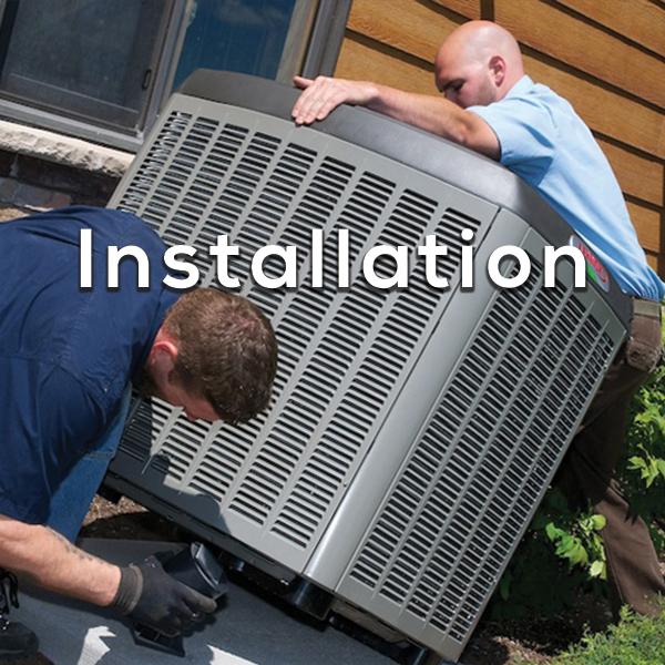 HVAC Installations - Men installing AC Unit