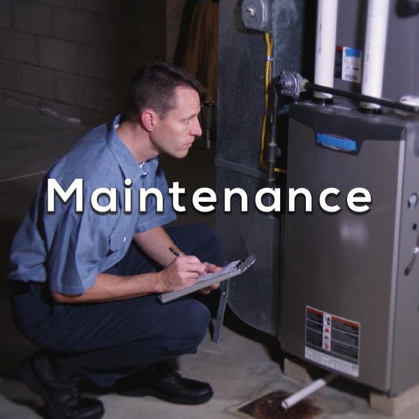 HVAC Maintenance - Man checking furnace
